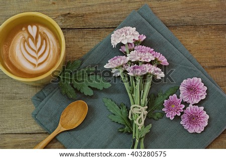 Coffee with flowers on wooden table - adjust with Warm tone. - stock photo