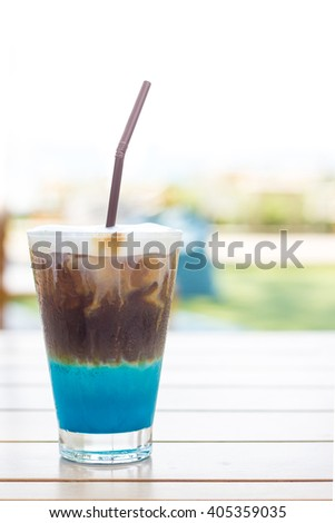 Coffee with liqueur and whipped milk  - stock photo