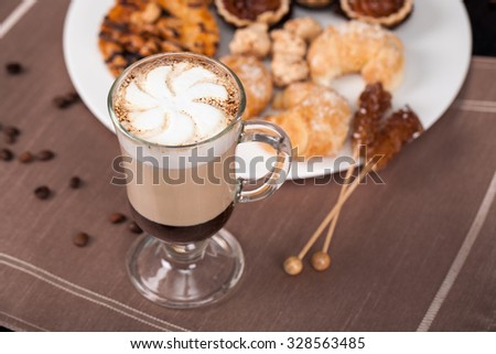coffee with milk and cakes