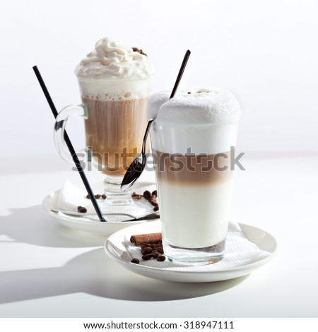 Coffee with Milk and Latte Macchiato Coffee over White - stock photo