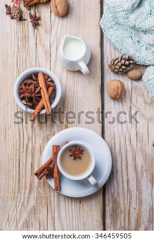 coffee with milk and spices on a wooden table. top view - stock photo