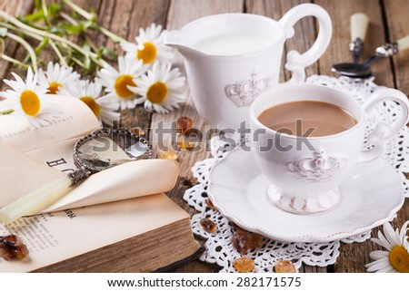 Coffee with milk,Breakfast in the morning with a book and flowers.selective focus - stock photo