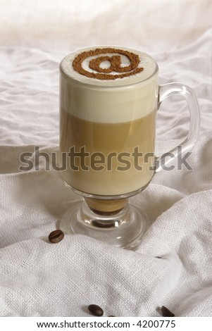 Coffee with milk, in glass with sign , on the white back ground. - stock photo