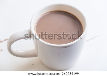 Coffee with milk or cream seen from above - stock photo