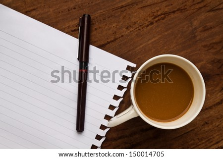 coffee with note and pen  on old  wood background - stock photo