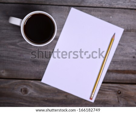 Coffee with white blank paper