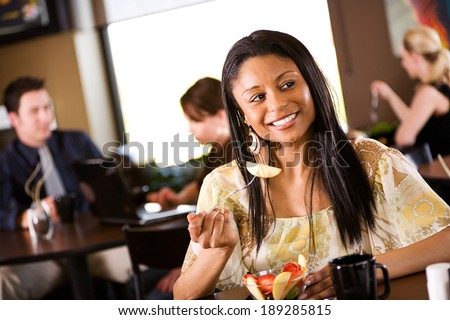 Coffee: Woman Having Lunch In Restaurant - stock photo