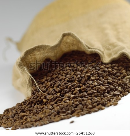 Coffeebeans in brown canvas bag isolated on white background - stock photo