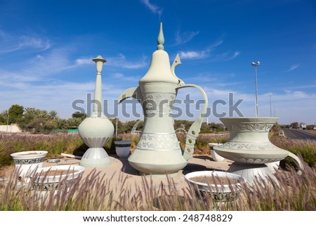 Coffeepot sculpture in a roundabout in Al Ain, Emirate of Abu Dhabi, UAE - stock photo