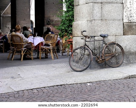 Coffeeshop and an old bike - stock photo