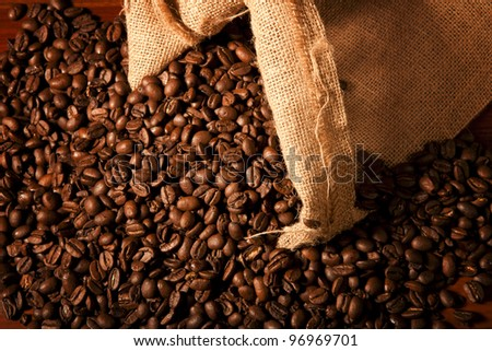 Coffew beans coming out of a sack ready to be dusted - stock photo