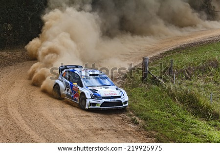 COFFS HARBOUR, AUSTRALIA - SEP 14: Norvegian crew A. MIKKELSEN, O. FLOENE in a Volkswagen Polo R WRC 2014 race in Coffs Harbour , Australia on 14 September 2014 - stock photo