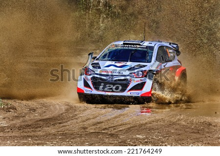 Coffs Harbour, Australia - September 14, 2014: Hyundai motosport crew C. ATKINSON, S. PREVOT World Rally in a Hyundai i20 WRS at WRC 2014 race super stage water crossing - stock photo
