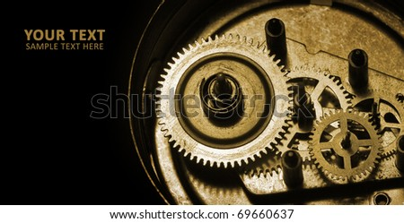 coghwheels in old clock with space for text - stock photo