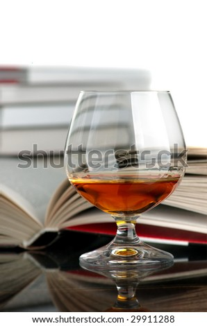 Cognac and books - stock photo