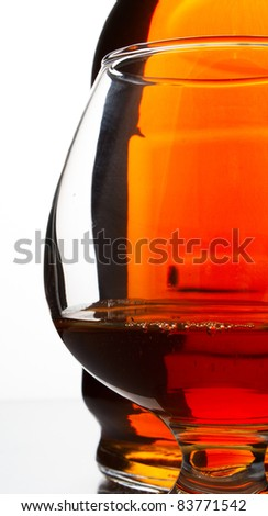 cognac bottle and filled glass - stock photo