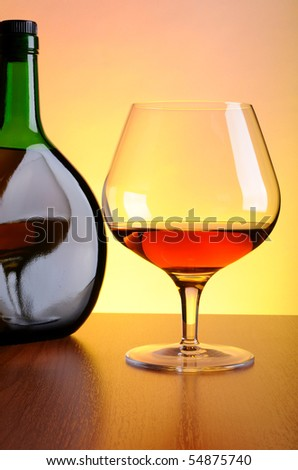Cognac bottle and glass - stock photo