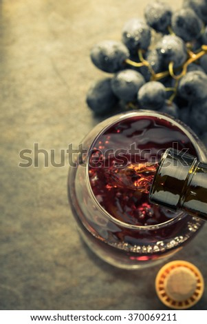 cognac glass and grapes on table
