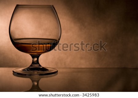 cognac glass in vintage  background - stock photo