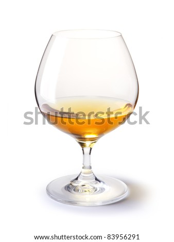 cognac glass with gold cognac on a white with shadow - stock photo