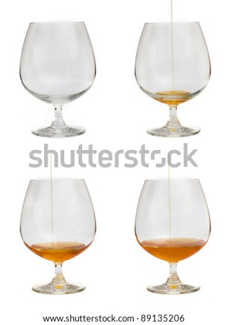 Cognac glasses isolated on white background - stock photo