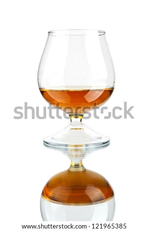 cognac in glass on a white background - stock photo