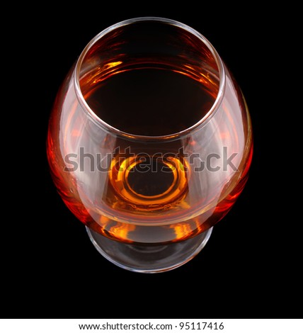 cognac in goblet isolated on black background - stock photo