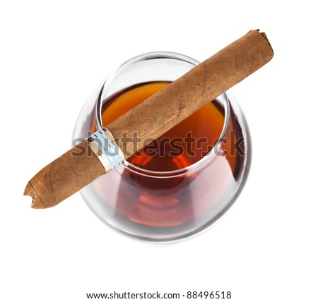 cognac in goblet with cigar isolated on white background - stock photo