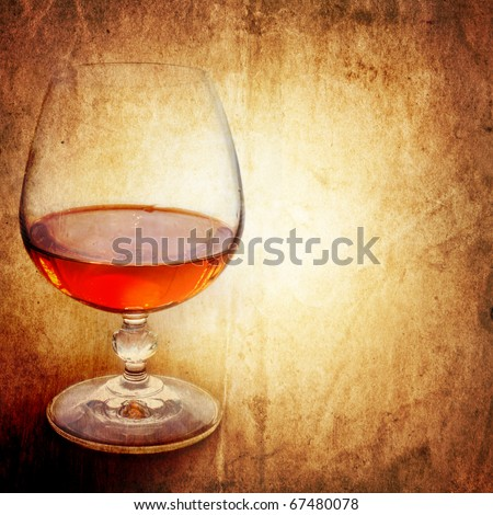 Cognac on an ancient background - stock photo