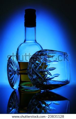 cognac on colour light background - stock photo