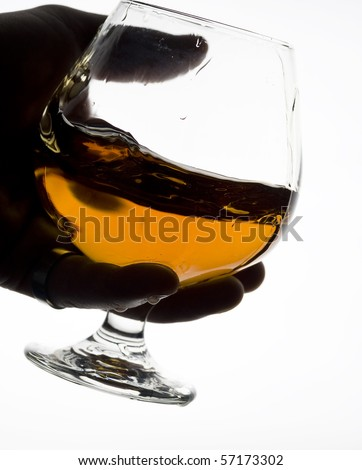 Cognac on the glass . Brown scotch - stock photo