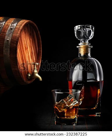 Cognac or brandy on a black background