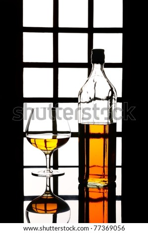 Cognac, whisky, rum, wine glass and bottle - stock photo