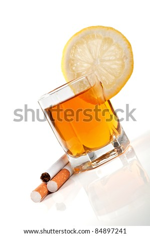 cognac with lemon and cigarettes isolated on a white background - stock photo