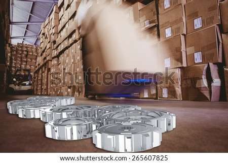 cogs and wheels against worker with fork pallet truck stacker in warehouse - stock photo