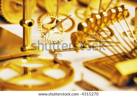 Cogs from a Grandfather clock - stock photo