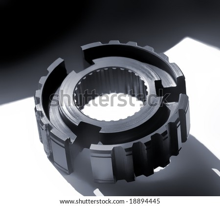 Cogwheel over black and white background with room for latter text.Shallow DOF - stock photo