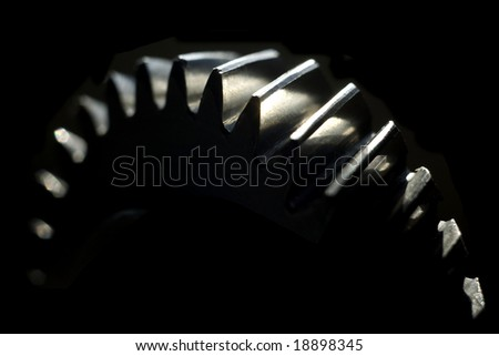 Cogwheel over black background with room for latter text.Shallow DOF - stock photo