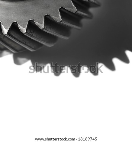 Cogwheel over white background with room for latter text.Shallow DOF - stock photo