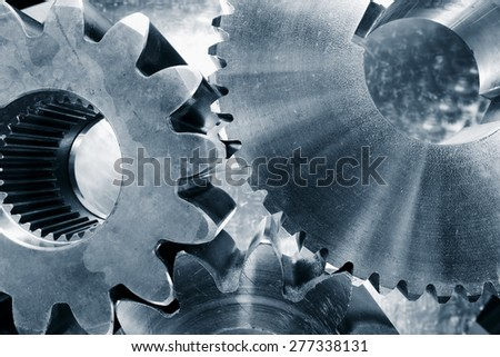 cogwheels and gear parts titanium and steel, duplex blue toning concept - stock photo