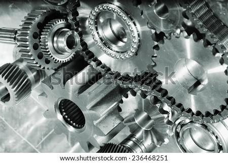 cogwheels and gears against titanium