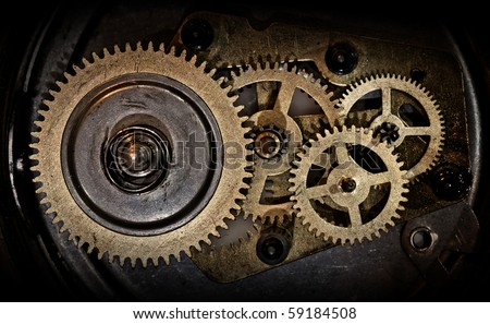 cogwheels in old clock - stock photo