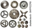 Cogwheels, pulleys, screw heads and other metal details - stock photo