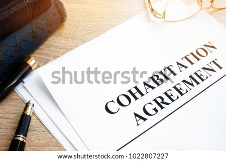 Cohabitation agreement books on table stock photo 1022807227 cohabitation agreement and books on a table platinumwayz