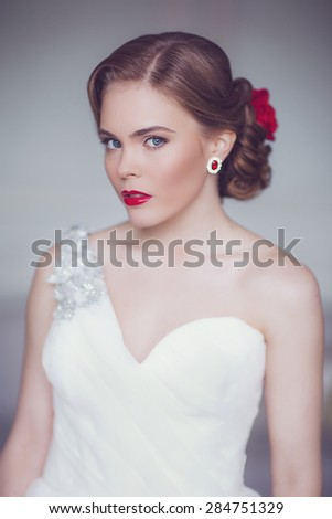Coiffure of Young Beautiful Attractive Bride with Flowers. White Dress and Wedding Decorations. Vintage Toning - stock photo