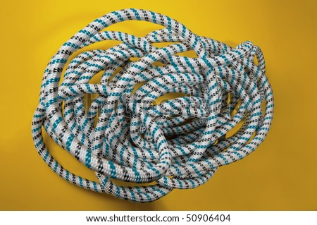 coil of rope on yellow background