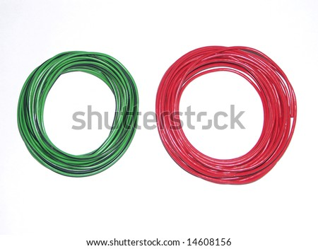 coil of wire red and green on white background - stock photo