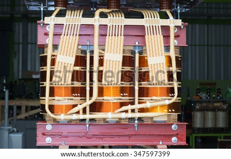 coil transformer high voltage - stock photo