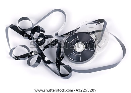 Coil with a magnetic videotape on a white background - stock photo