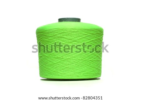 Coil with green thread on white background - stock photo